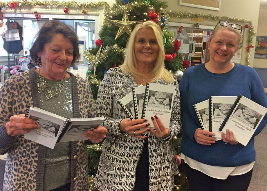 Arts Commissioner Emily Areson, Senior Center receptionist Jeannie Franco and Human Services Director Michele Jakab have the Trumbull Friends & Neighbors' Recipe Book available for $7 at the Senior Center. Photo: Donald Eng / Hearst Connecticut Media