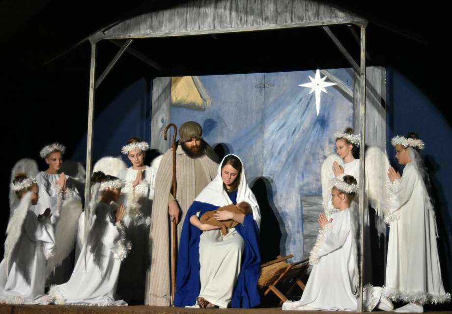 Sparkly-winged angels throng around the Holy Family including Mary and Joseph, portrayed by Kristin and Alec Braddock in this scene from the 21st anniversary production of the Nazareth Christmas Pageant set for 7:30 p.m. performances on Dec. 22 and 23 at the Holy Family Church in Nazareth. Many of the women involved in the production got their start depicting child angels in Pageants of the past. Photo: Photo By Jim Steiert/Courtesy Photo