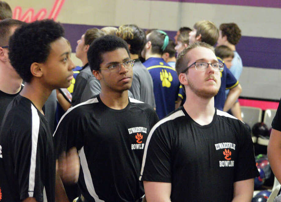 Edwardsville bowlers, left to right, Derrick Newsome, Eian Sims and Michael Jenkins listen to coach Craig Ohlau during Wednesday's third round of the Southwestern Conference Tournament at Camelot Bowl in Collinsville. Photo: Scott Marion/The Intelligencer