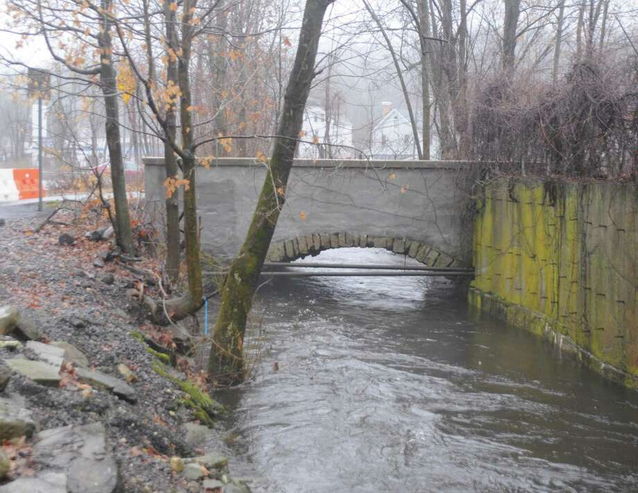 Depot Road Bridge will cost an estimated $2.3 million to repair, with the town's share $354,000. Water was high during the rains Dec. 14, 2019. An orange barrier closing the bridge is at far right. Photo: Macklin Reid / Hearst Connecticut Media