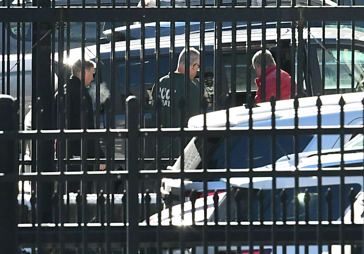 Ex-Guilderland Town Justice Richard Sherwood, center, is led out the back of the Federal Courthouse for transport after his sentencing for his role in the theft of nearly $12 million from the accounts of elderly clients on Thursday, Dec. 19, 2019 in Albany, N.Y. (Lori Van Buren/Times Union)