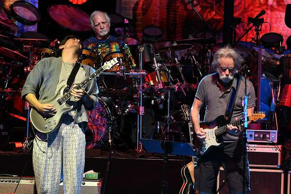 "Dead & Company including John Mayer, left, Bill Kreutzmann, center, and Bob Weir perform the song ""Jack Straw"" at Saratoga Performing Arts Center on Monday, June 11, 2018 in Saratoga Springs, N.Y. (Lori Van Buren/Times Union)"