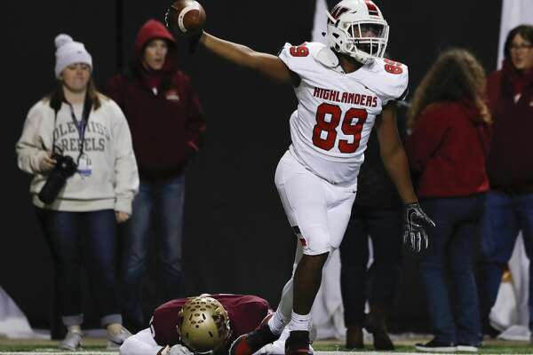 The Woodlands wide receiver Brenden Langford-Johnson (89) reacts after hauling in a 12-yard touchdown pass over Cypress Woods defensive back Trajan Armstrong (12) during the third overtime period of a Region II-6A area high school football playoff game at Cy-Fair FCU Stadium, Friday, Nov. 22, 2019, in Cypress. The Woodlands defeated Cypress Woods 34-28 in triple overtime.