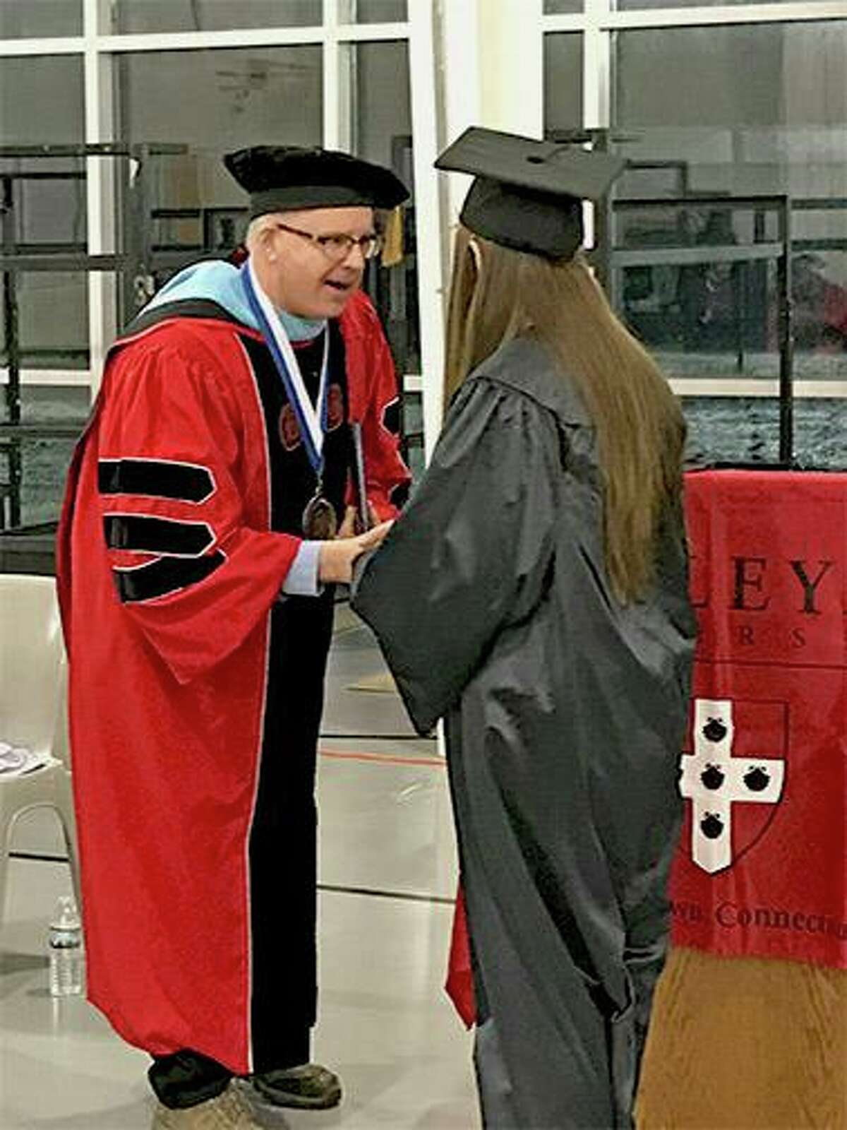 Tracy Shumaker, one of the seven women who received her associate's degree through Wesleyan University's Center for Prison Education, spoke during the recent graduation ceremony at York Correctional Institution in Niantic.