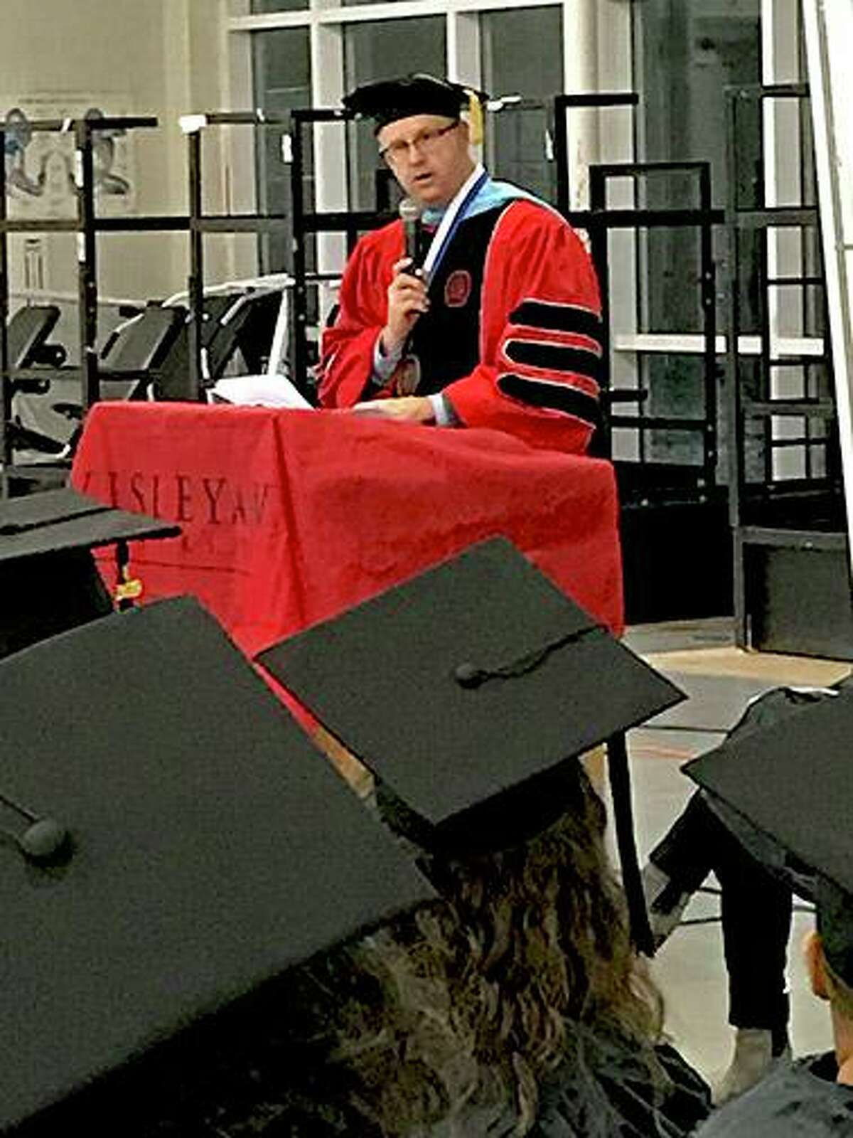 Dr. Steven Minkler, campus chief executive officer, Middlesex Community College, addresses graduates and attendees of the graduation ceremony at York Correctional Institution Tuesday.