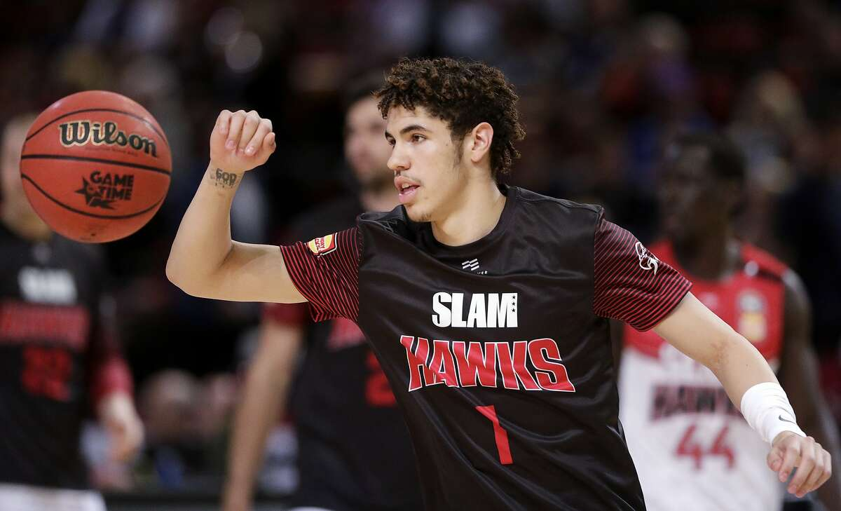 LaMelo Ball of the Illawarra Hawks warms up before their game against the Sydney Kings in the Australian Basketball League in Sydney, Sunday, Nov. 17, 2019. (AP Photo/Rick Rycroft)
