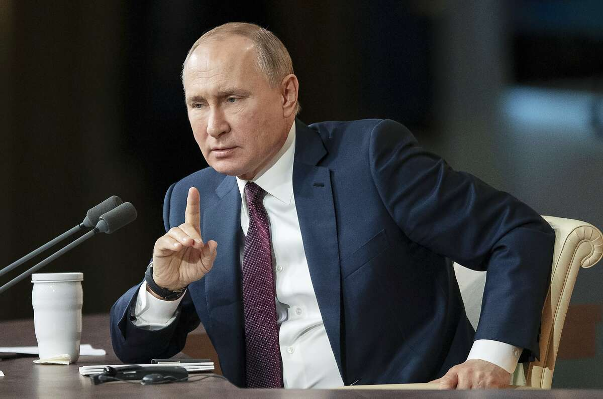 Russian President Vladimir Putin gestures during his annual news conference in Moscow, Russia, Thursday, Dec. 19, 2019. Putin said Thursday that U.S. President Donald Trump was impeached for