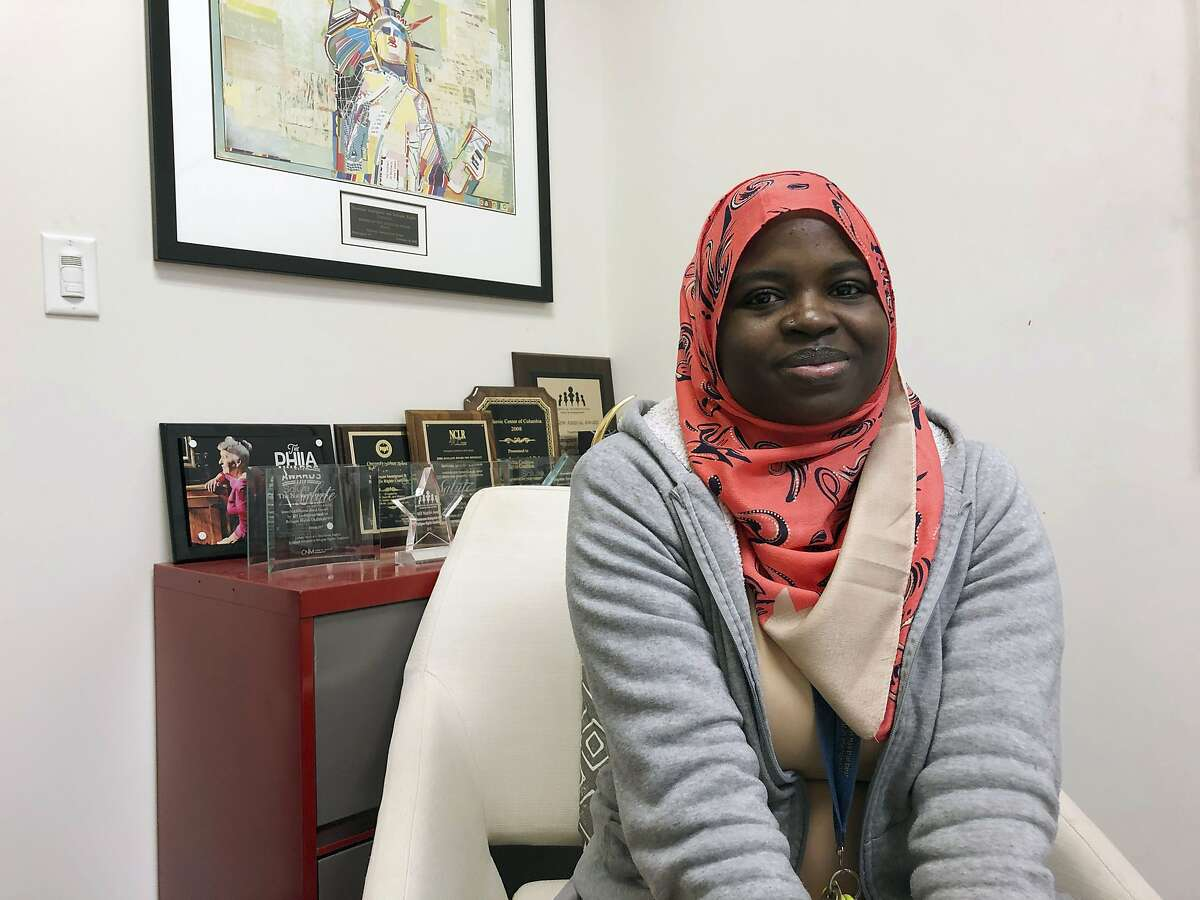 In this Tuesday, Dec. 17, 2019 photo Fartun Abdi, a 25-year-old Somalian sits at work in Nashville, Tenn. Abdi arrived in the U.S. as refugee with her mother and two step-siblings. She now works as a refugee case assistant for Catholic Charities. Abdi said she voted for Lee and prayed over his refugee decision. Tennessee won't stop resettling refugees, Republican Gov. Bill Lee said Wednesday, Dec. 18, 2019, rejecting the option offered to states by President Donald Trump's administration. (AP Photo/Jonathan Mattise)