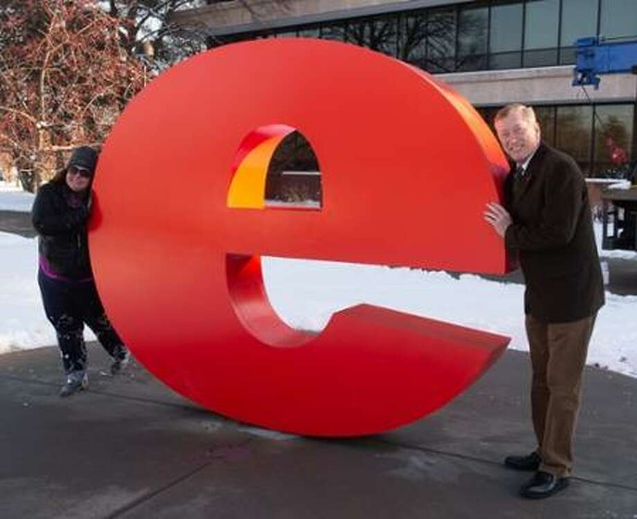 "Working to bring the ""e"" sculpture to fruition and to campus were Southern Illinois University Edwardsville Creative Director Heather Kniffel, left, and Vice Chancellor for Administration Rich Walker."