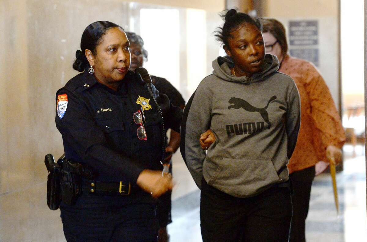 Brittanie Thomas is taken into custody by a Jefferson County Sheriff's officer shortly after arriving at the 317th District court for a status hearing with CPS regarding her children's placement. She was arrested for a charge of injury to a child. Photo taken Thursday, December 19, 2019 Kim Brent/The Enterprise