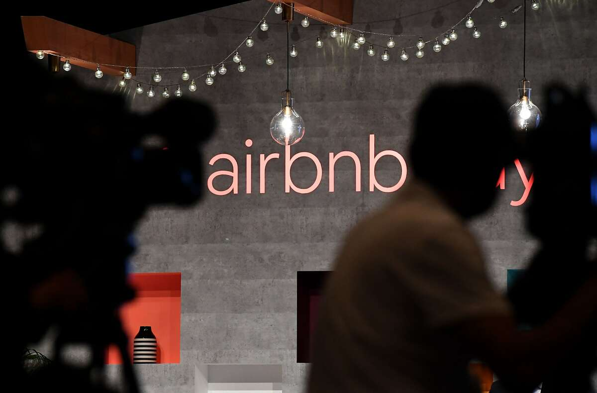 In this file photo taken on June 14, 2018 the US rental site Airbnb logo is displayed during the company's press conference in Tokyo.