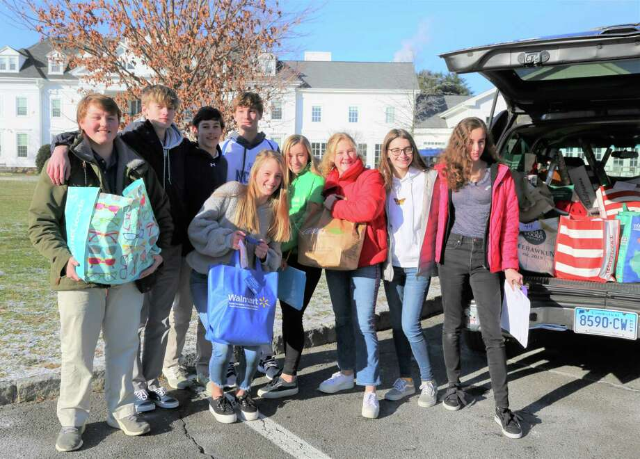 "Members of New Canaan Country School's Ninth Grade Service Leadership Committee Thatcher Findlay, Brayden Hogue, Ryland Strine, Jamie Staniar, Payton Koch, Annika Mannix, Maren Frey, Sasha Coughlin and Darla Moody helped oversee the gathering, packing and delivery of ""Dove Bags"" filled with food and other necessary items for 46 local families in need, Dec. 19. Photo: Contributed Photo"