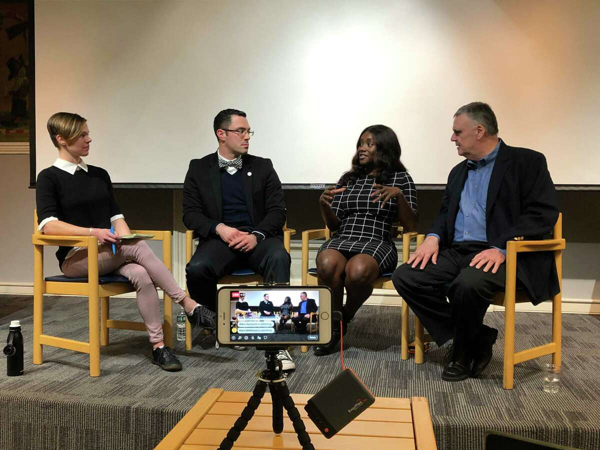 CT Insider's Lindsay Boyle moderates a panel discussion on news literacy at the New Haven Free Public Library featuring Mike Savino, Mercy Quaye and Richard Hanley.