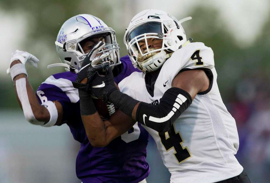 Conroe wide receiver Michael Phoenix (4) was a first-team all-state selection after racking up 1,399 yards and 22 touchdowns this season. Photo: Jason Fochtman, Houston Chronicle / Staff Photographer / Houston Chronicle