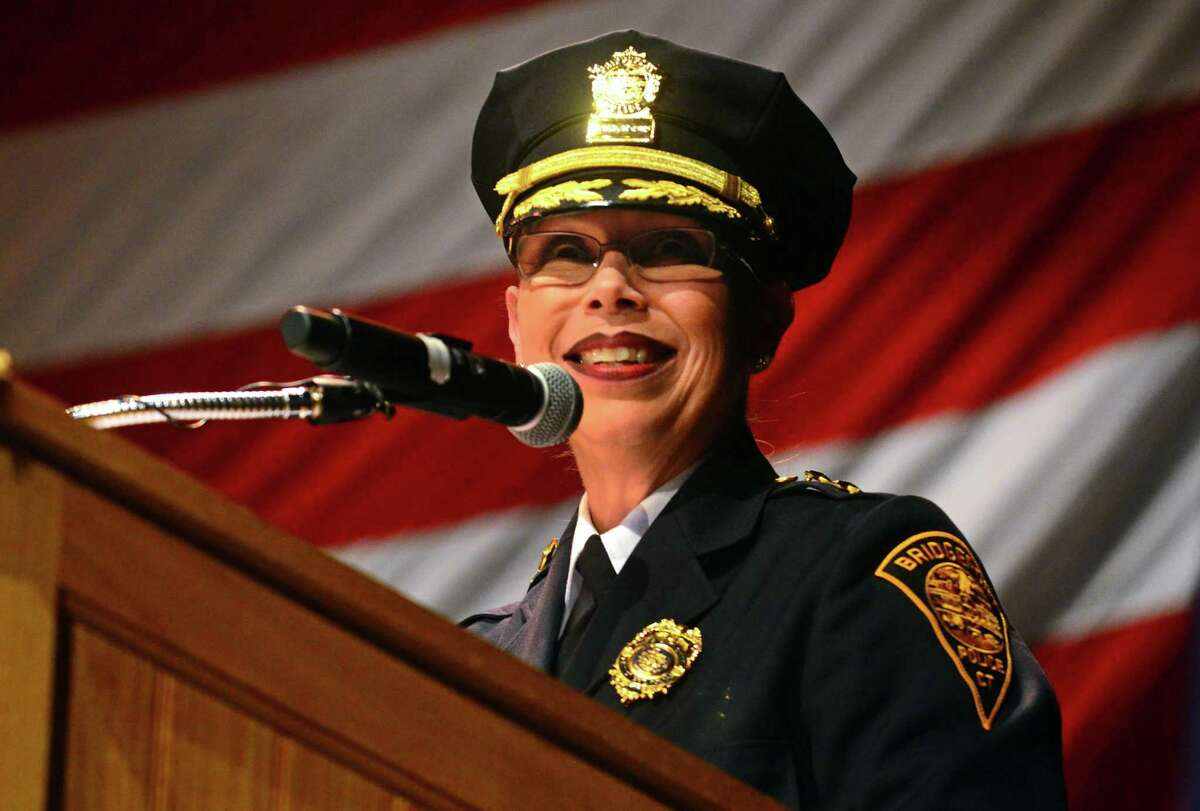 Rebeca Garcia speaks after being sworn-in as Bridgeport's first Hispanic assistant police chief during the 41st Annual Basic Training Session Graduation Ceremony at University of Bridgeport's Arnold Bernhard Center in Bridgeport, Conn., on Wednesday Dec. 18, 2019.