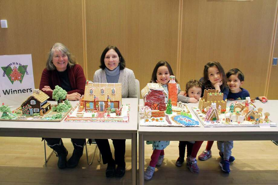 "Winners of the second annual ""How Sweet It Is in Wilton"" gingerbread house contest, from left, Tina Duncan, Viv Stewart (Halli Stweart missing), Aurora, Winnie and Sabrina Gulati, and Amir Rahamim. Photo: Janet Crystal Photo / Wilton Bulletin Contributed"