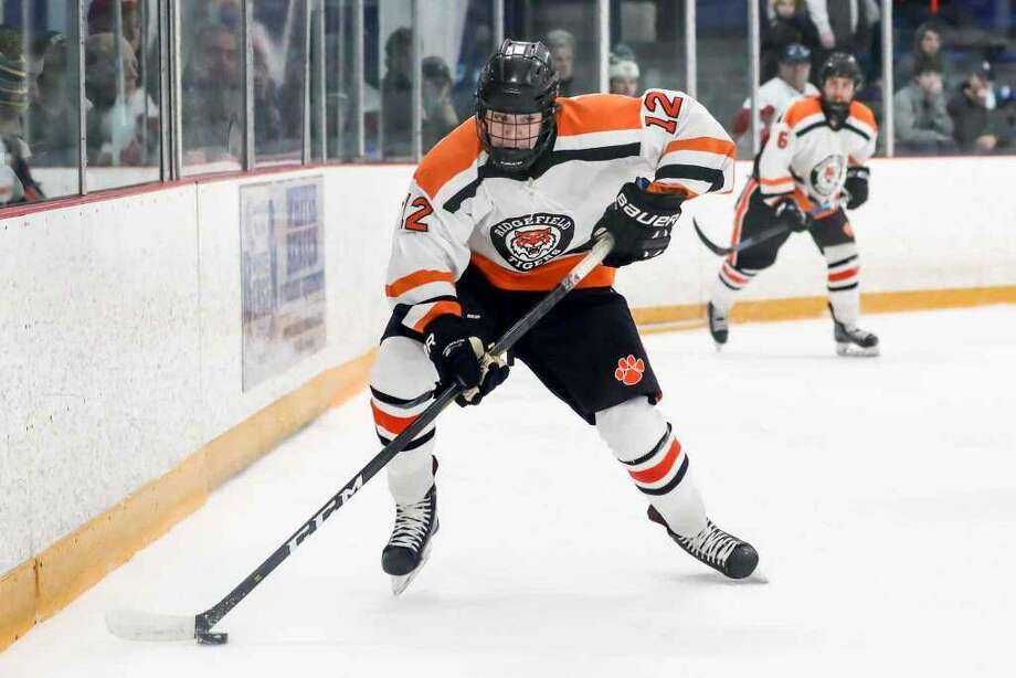 Luke Welsh and the Ridgefield boys hockey team began the season with a 2-1 loss to reigning Division I state champion Fairfield Prep. Photo: John McCreary / For Hearst Connecticut Media