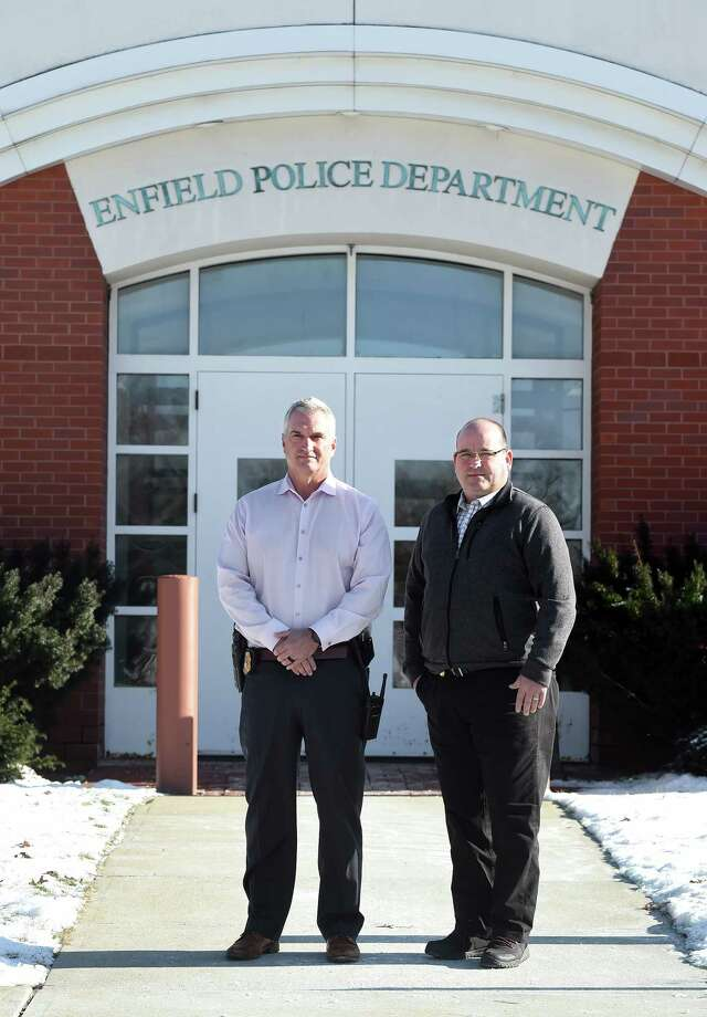 Detective Brian Callaghan (left) and Detective Lt. Willie Pedemonti are photographed in front of the Enfield Police Department on December 19, 2019. Photo: Arnold Gold, Hearst Connecticut Media / New Haven Register