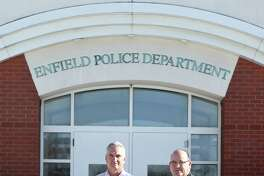 Detective Brian Callaghan (left) and Detective Lt. Willie Pedemonti are photographed in front of the Enfield Police Department on December 19, 2019.