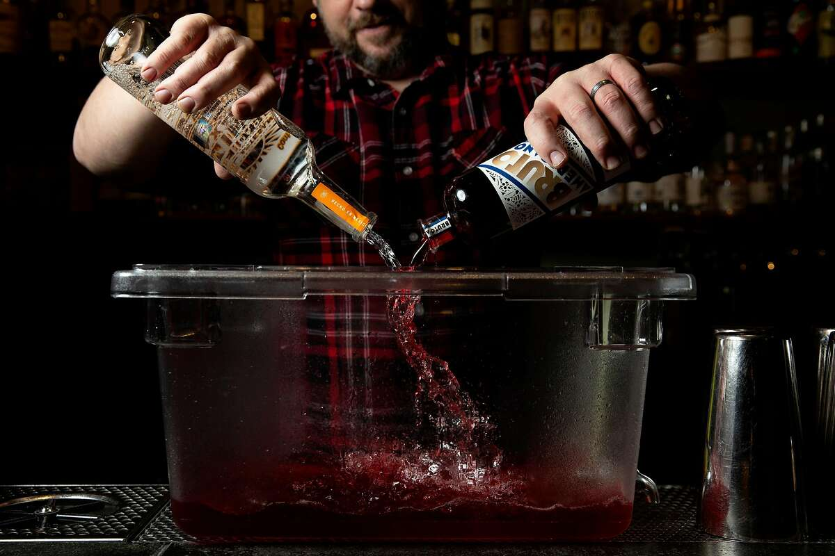Jeff Lyon makes a batch of the Inquisitor cocktail (mezcal, bonal, bruto americano, amaro, habanero tincture) at Third Rail cocktail and jerky bar on Wednesday, Dec. 18, 2019, in San Francisco, Calif. Lyon is the bar owner.
