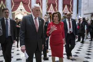 House Majority Leader Rep. Steny Hoyer (D-MD) and House Speaker Nancy Pelosi (D-CA) walk from the House floor. The House of Representatives overwhelmingly approved the USMCA trade pact signed by President Donald Trump with Canada and Mexico to revamp NAFTA.