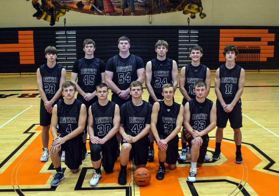 Members of the Harbor Beach boys varsity basketball team are, front row, from left, Nathan Siemen, Luke Woodke, Dakota Deer, Dylan Kadar and Riley Deer; back row, Jayson Siemen, Grant Smaglinski, Evan Smaglinski, Parker Jahn, Michael Anderson and Mason Booms. Photo: Ashley Wehner/Memories By Ashley Photography