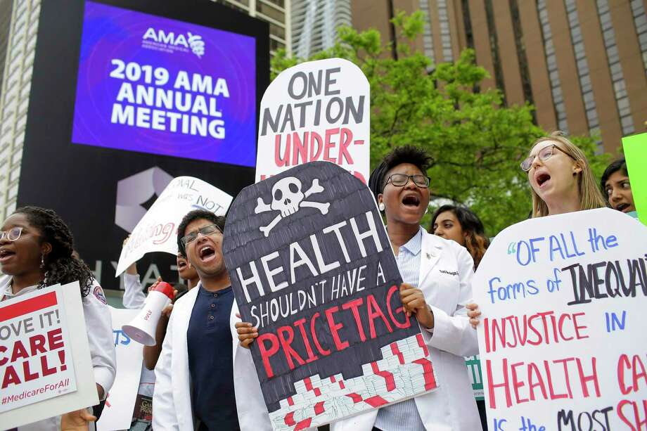 Medical students rally for 'Medicare for All' in Chicago in June. A reader wonders how far that support goes. Photo: Joshua Lott /New York Times / NYTNS