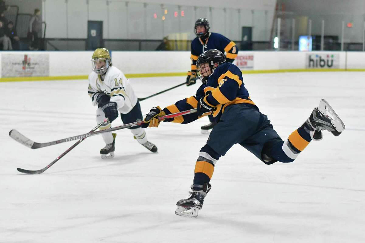 Cole Chapman (6) of the Simsbury Trojans fires a shot during a game against the Notre Dame Fairfield Lancers on Wednesday January 16, 2019 at The Rinks in Shelton, Connecticut.