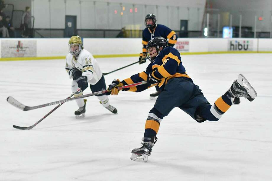 Cole Chapman (6) of the Simsbury Trojans fires a shot during a game against the Notre Dame Fairfield Lancers on Wednesday January 16, 2019 at The Rinks in Shelton, Connecticut. Photo: Gregory Vasil / For Hearst Connecticut Media / Connecticut Post Freelance