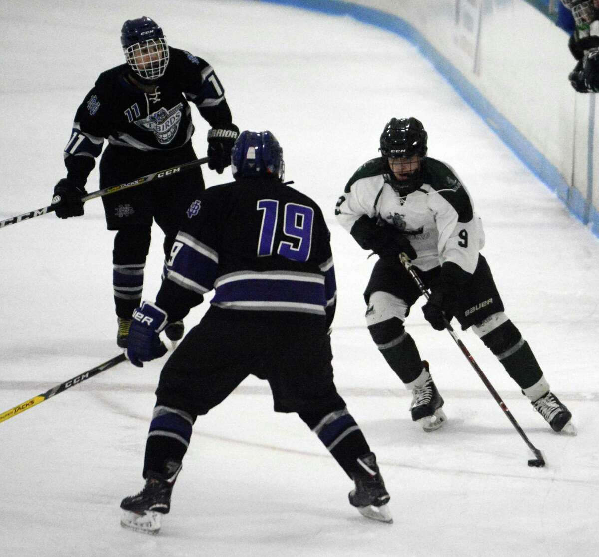 Guilford's Jack Dacey (9) looks to skate past North Branford's Griffin Geist (19) on Jan. 9, 2019 at DiLungo Rink in East Haven, Conn.