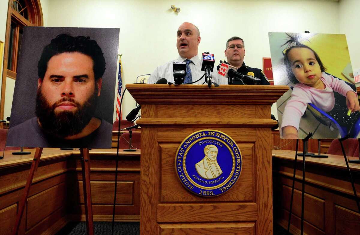 Ansonia Police Department's Chief Andrew Cota updates the media on missing one-year-old Vanessa Morales during a press conference held at Ansonia City Hall in Ansonia, Conn., on Tuesday Dec. 3, 2019. At left is the photo of Vanessa's father Jose Morales, who has been named a suspect in the death of Vanessa's mother Christine Holloway.
