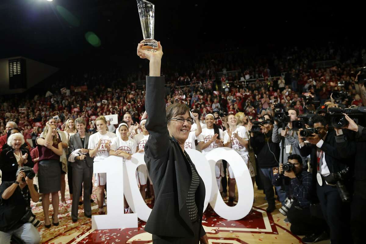 Stanford head coach Tara VanDerveer waves to the crowd after her 1,000th career win, in an NCAA college basketball game against Southern California on Friday, Feb. 3, 2017, in Stanford, Calif. (AP Photo/Marcio Jose Sanchez)
