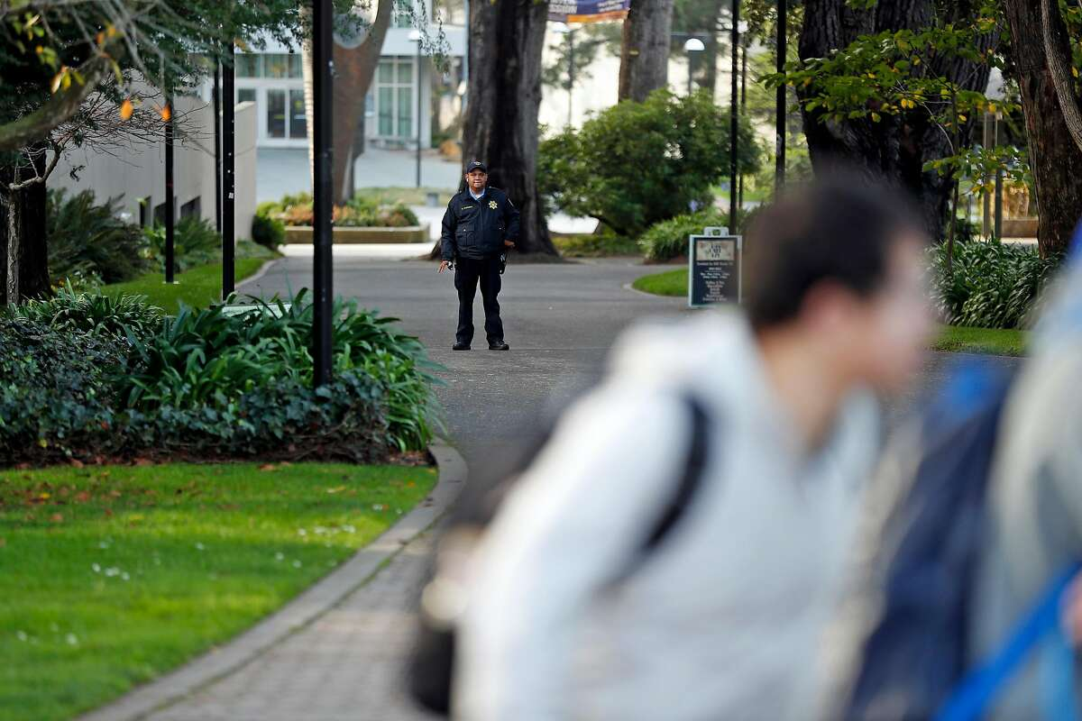 A security officer stands guard during a bomb threat at San Francisco State University in San Francisco, Calif., on Thursday, December 19, 2019.