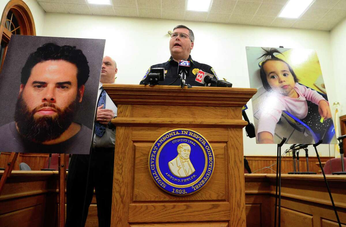 Ansonia Police Department's Lt. Patrick Lynch updates the media on missing one-year-old Vanessa Morales during a press conference held at Ansonia City Hall in Ansonia, Conn., on Thursday, Dec. 19, 2019. At left is the photo of Vanessa's father Jose Morales, who has been named a suspect in the death of Vanessa's mother Christine Holloway.