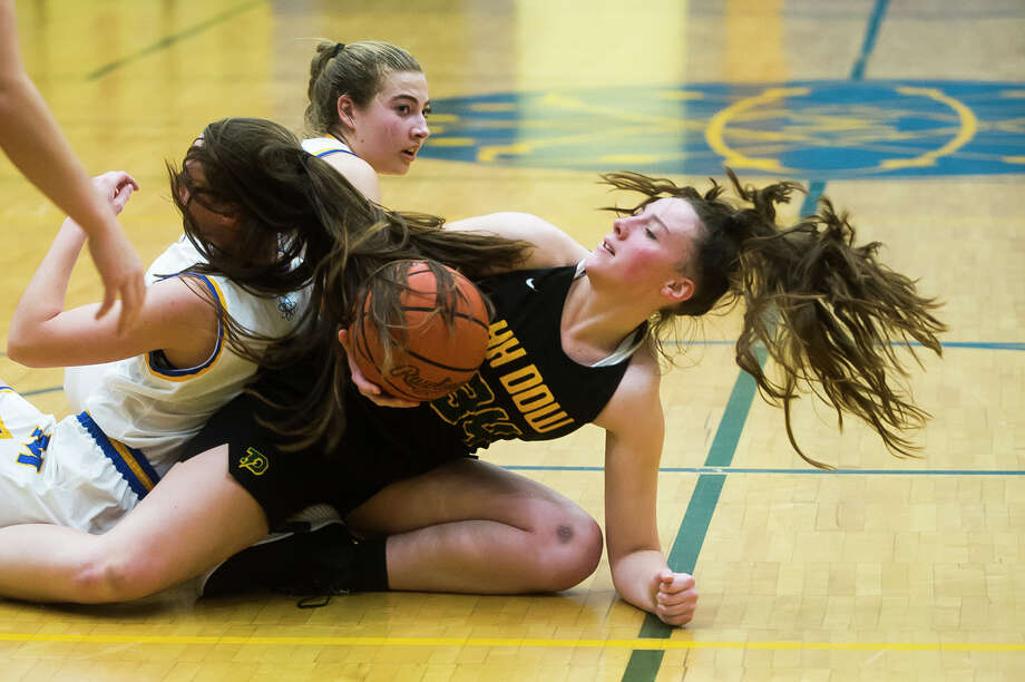 Dow's Alyssa Keptner grabs hold of the ball during the Chargers' game against Midland Thursday,Dec. 19, 2019 at Midland High School. (Katy Kildee/kkildee@mdn.net) Photo: (Katy Kildee/kkildee@mdn.net)