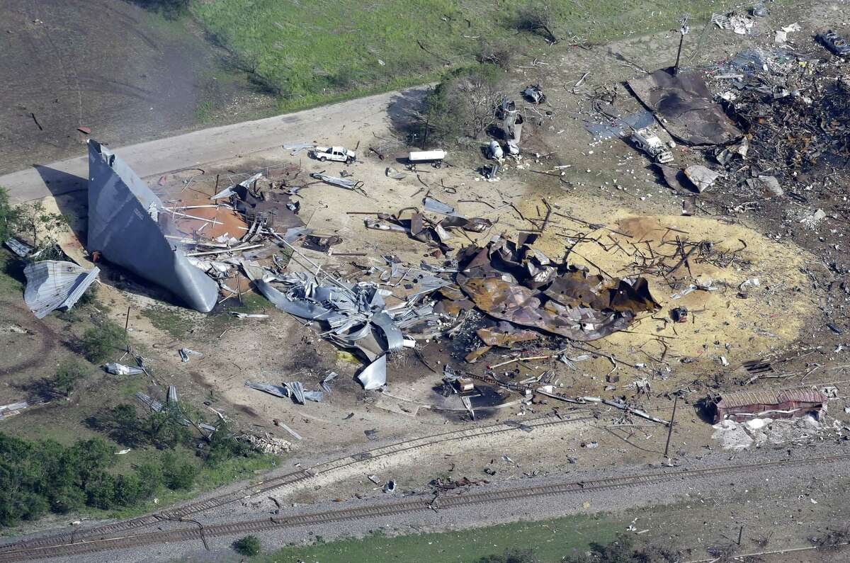 This aerial photo shows the remains of a fertilizer plant destroyed by an explosion in West, Texas, Thursday, April 18, 2013. A massive explosion at the West Fertilizer Co. killed as many as 15 people and injured more than 160, officials said overnight. The explosion that struck around 8 p.m. Wednesday, sent flames shooting into the night sky and rained burning embers and debris down on shocked and frightened residents. (AP Photo/Tony Gutierrez)
