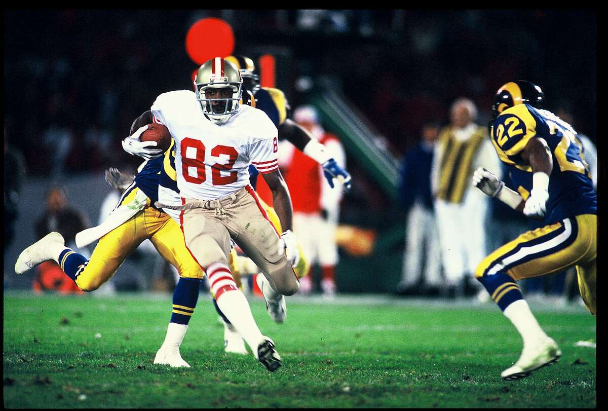 John Taylor on his way to a 95-yard touchdown catch-and-run in the 49ers' 30-27 win over the Rams on Dec. 11, 1989.