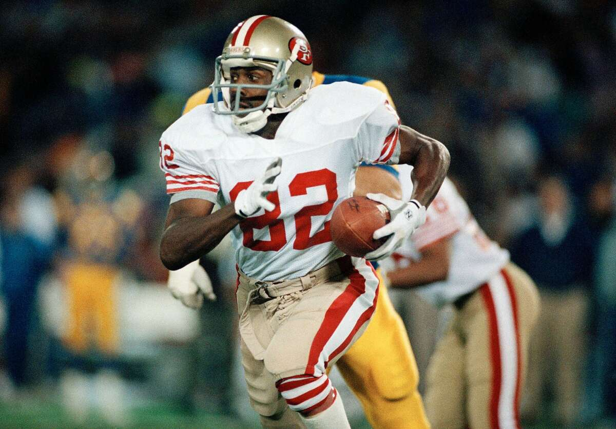 San Francisco 49ers wide receiver John Taylor (82) returns a punt in the second quarter against the Los Angeles Rams at Anaheim Stadium in Anaheim on Dec. 11, 1989. Taylor had 11 catches for 286 yards. The 49ers beat the Rams 30-27.(AP Photo/Bob Galbraith)