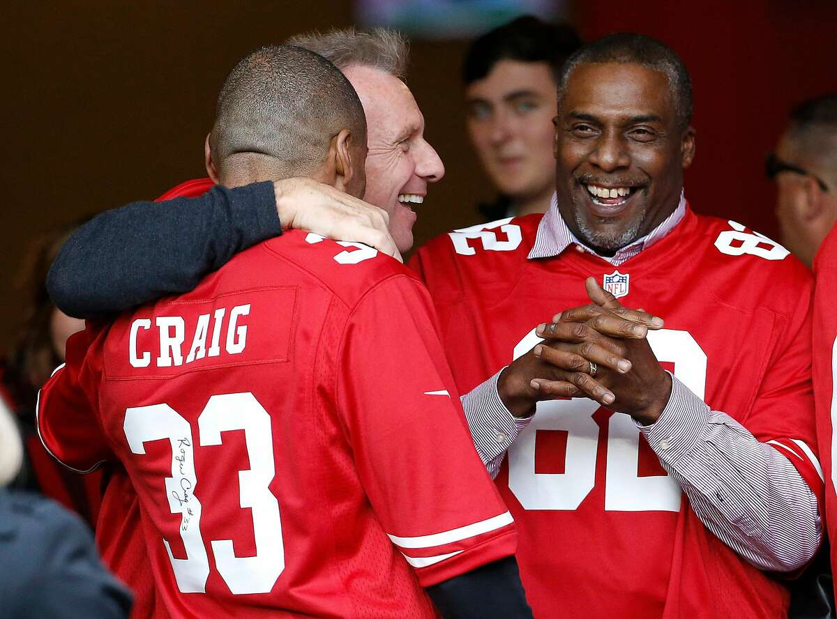 Former San Francisco 49ers players Roger Craig, from left, Joe Montana, and John Taylor gather before a halftime ceremony during an NFL football game between the 49ers and the Cincinnati Bengals in Santa Clara, Calif., Sunday, Dec. 20, 2015. (AP Photo/Tony Avelar)