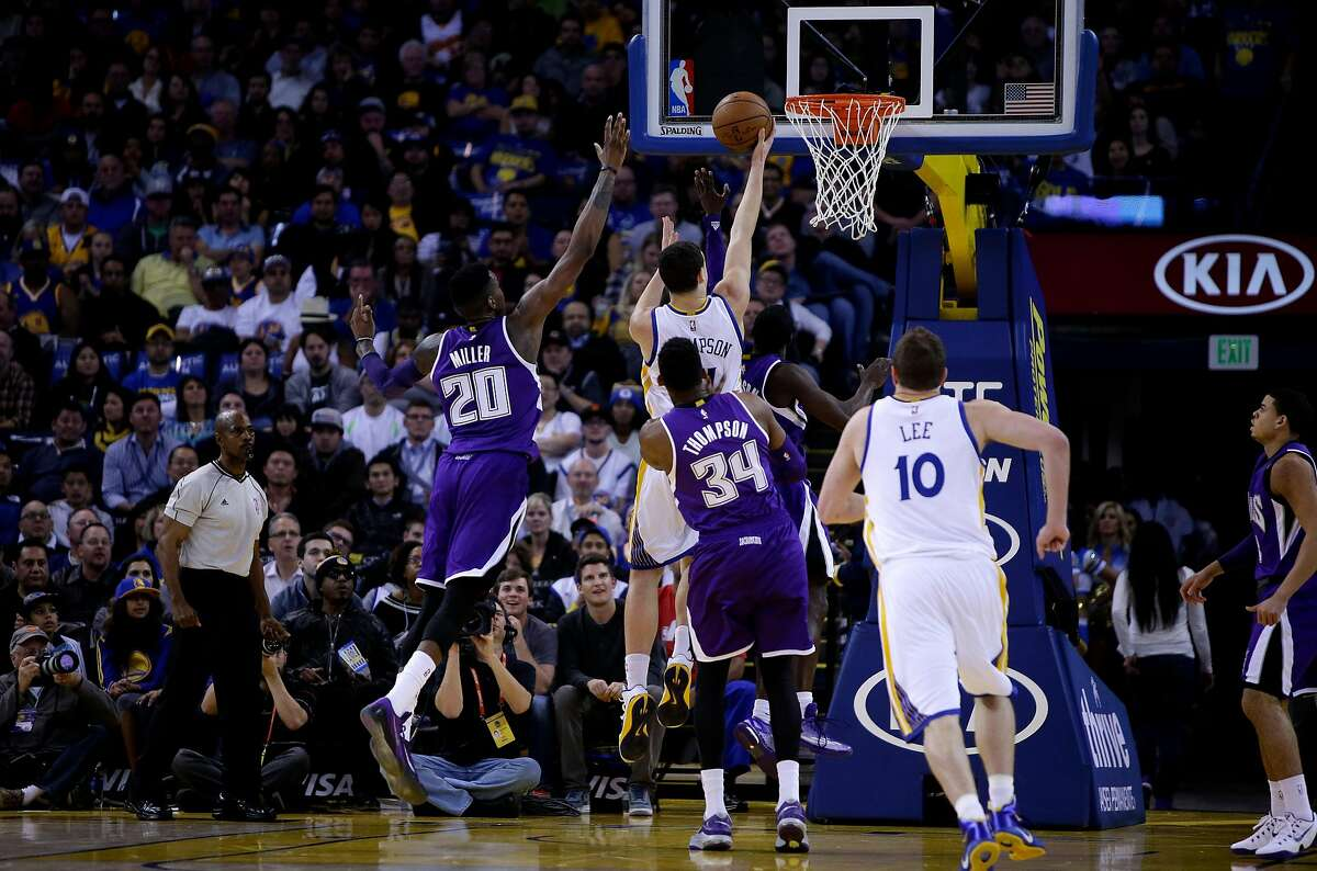 OAKLAND, CA - JANUARY 23: Klay Thompson #11 of the Golden State Warriors goes up for a shot on Quincy Miller #20 of the Sacramento Kings in the third quarter of their game at ORACLE Arena on January 23, 2015 in Oakland, California. Thompson scored 37 poi