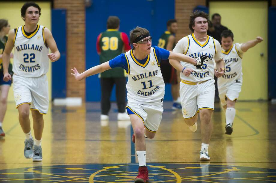Midland's Silas Pitt runs down the court after scoring a basket during a unified basketball game against Dow High, featuring students with special needs, Thursday, Dec. 19, 2019 at Midland High School. (Katy Kildee/kkildee@mdn.net) Photo: (Katy Kildee/kkildee@mdn.net)