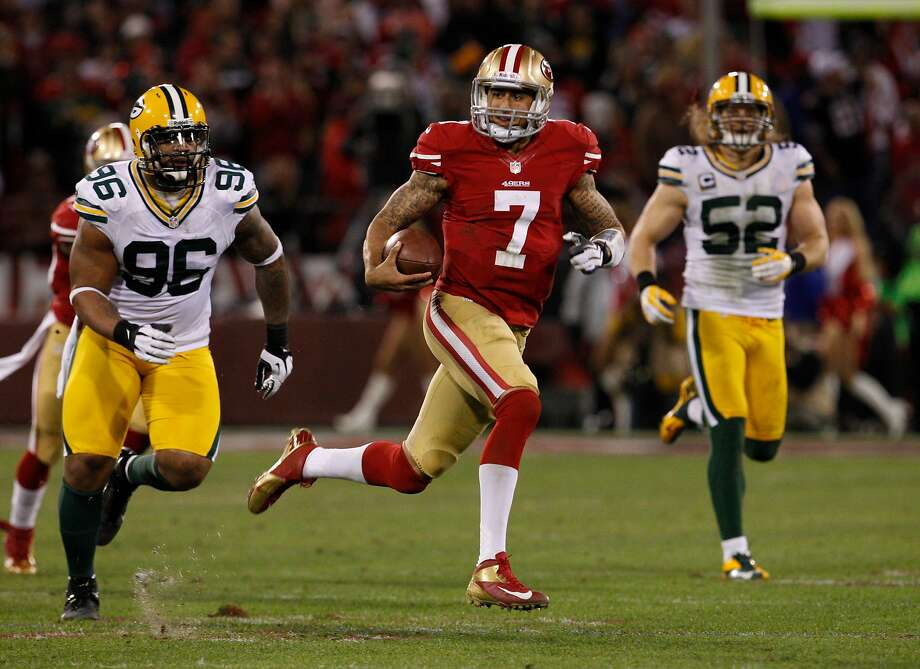 Quarterback Colin Kaepernick (7) is on a dash against the Green Bay Packers in the playoffs at Candlestick Park. Photo: Carlos Avila Gonzalez / The Chronicle 2013