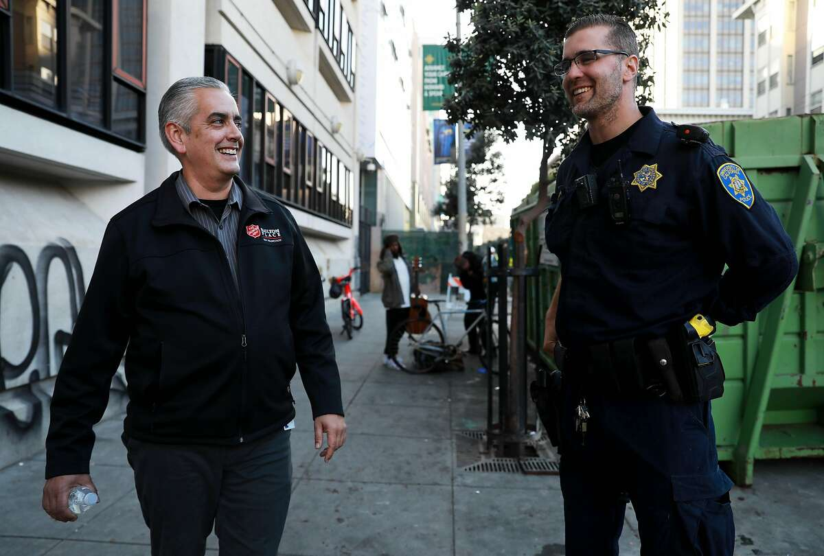 """Thomas Wolf, 49, speaks with Nick Jacobs, a police officer with the University of California, outside of the University of California Hastings College of Law building, on Golden Gate Ave., near the spot Wolf would sleep during his period of homelessness in San Francisco, Calif., on Tuesday, November 19, 2019. Wolf stated he recognized Officer Jacobs from his time living on the streets. Wolf was an employed father of two, husband and homeowner in Daly City before succumbing to opioid addiction and winding up homeless on the streets of the Tenderloin. Wolf has been sober since Sunday, June 24, 2018. He's currently employed full-time as a case manager at the Salvation Army, and has reconnected with his wife and children. """"People need to know there's a way out of you want it,"""" Wolf said. """"If you don't want it, you'll languish on the streets and die."""""""
