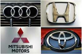 This undated combination of photos shows logos for clockwise from top left, Audi, Honda, Toyota and Mitsubishi Motors. The National Highway Traffic Safety Administration said in documents posted Thursday, Dec. 19, 2019, that it is investigating Audi, Toyota, Honda and Mitsubishi in connection with a Takata recall involving 1.4 million inflators. The inflators made by the now-bankrupt Takata have a new and distinct problem that can cause them to blow apart a metal canister and spew shrapnel into people's faces and bodies. (AP Photo)