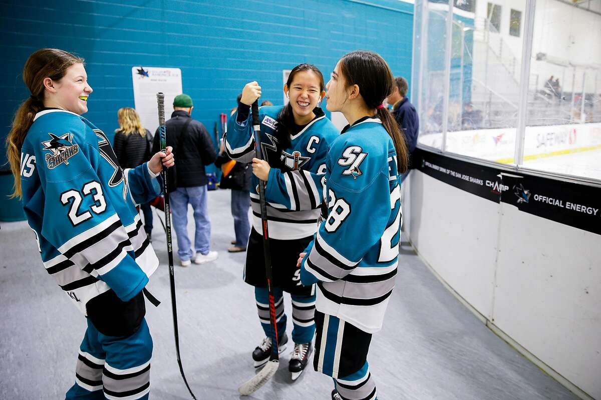 From left: San Jose Jr. Sharks Keira Kippen-Mallais (23), Natalie Fu (88) and Aiden Levee-Oshiro (28) of the Girls 14AAA team before the hockey game against the Stockton Colts at Solar4America Ice arena, Saturday, Dec. 7, 2019, in San Jose, Calif.
