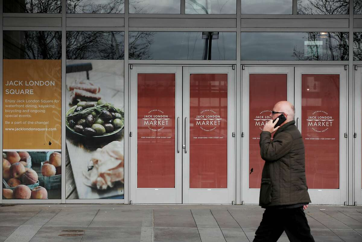 A man passes by Oakland Assembly, located at 44 Webster St., in Oakland, Calif., on Thursday, December 19, 2019. Oakland Assembly is a new food hall coming to Jack London Square in midsummer.