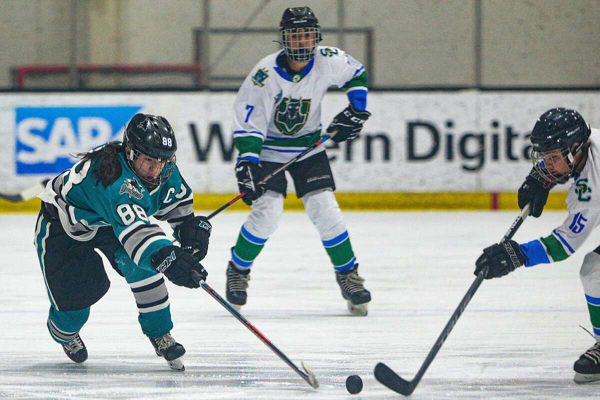 San Jose Jr. Sharks Natalie Fu (88) of the Girls 14AAA team battles for the puck against the Stockton Colts at Solar4America Ice arena, Saturday, Dec. 7, 2019, in San Jose, Calif.