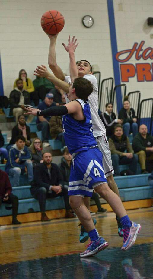 Bethel's Michael Schmidt (4) shoots over Tech's Blake Taylor (24) during the Henry Abbott Tech and Bethel high school game in The News-Time Greater Danbury Tip Off Classic basketball tournament, Thursday night, December 19, 2019, at Danbury High School, Danbury, Conn. Photo: H John Voorhees III / Hearst Connecticut Media / The News-Times