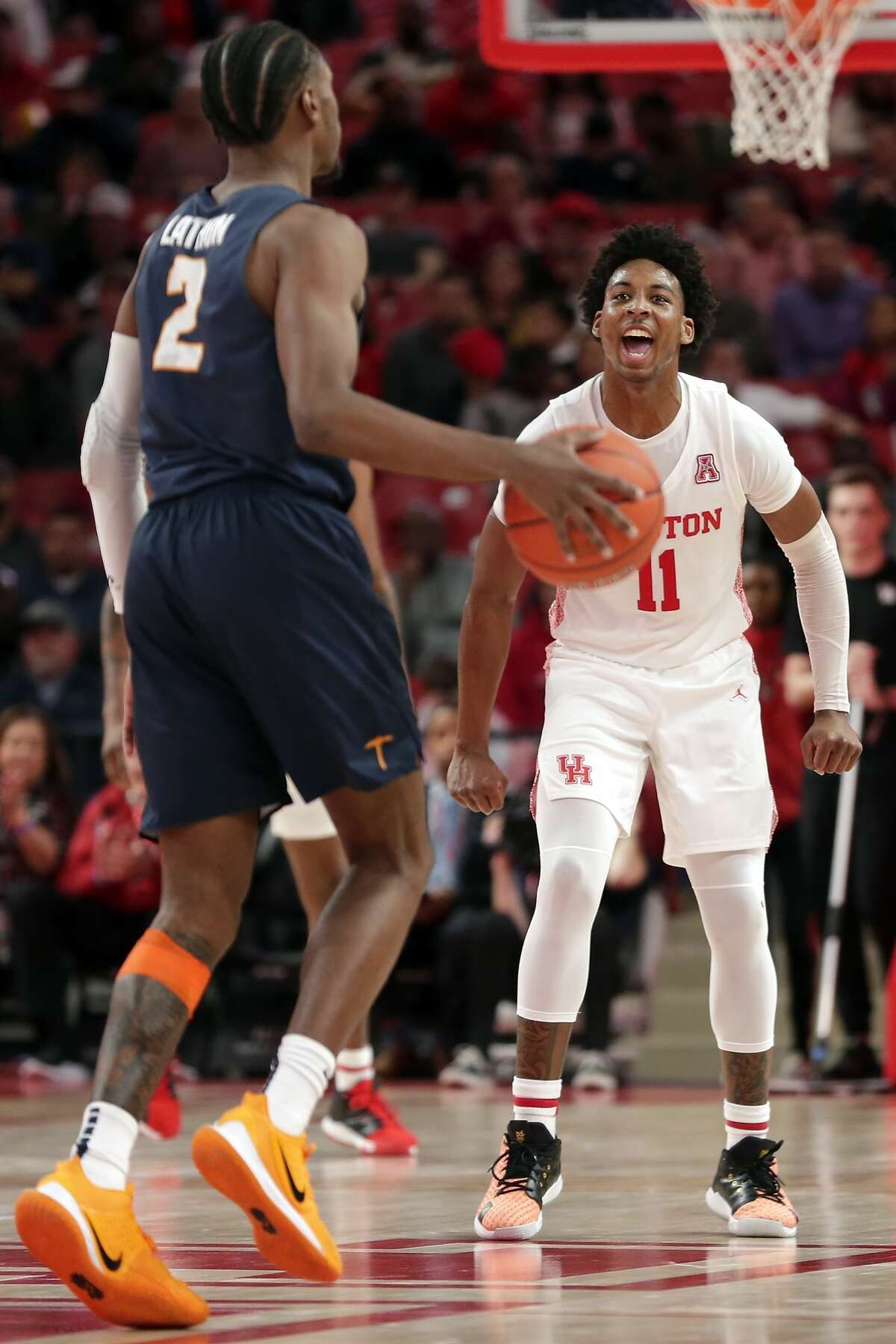 Houston guard Nate Hinton (11) continues his reaction after a three point shot as UTEP guard Jordan Lathon (2) brings the ball down during the second half of their game Thursday, Dec. 19, 2019 in Houston, TX.