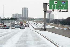 Weather conditions force closure of the Southwest Freeway inbound at Newcastle, Dec. 22, 1989.